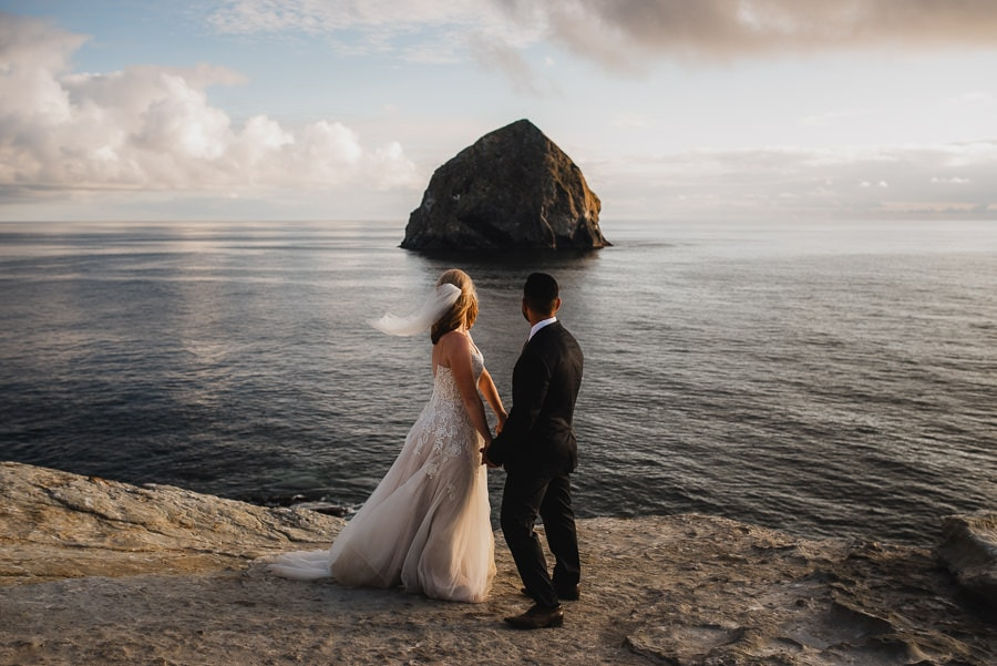 Bride and Groom overlooking the Oregon Coast at sunset