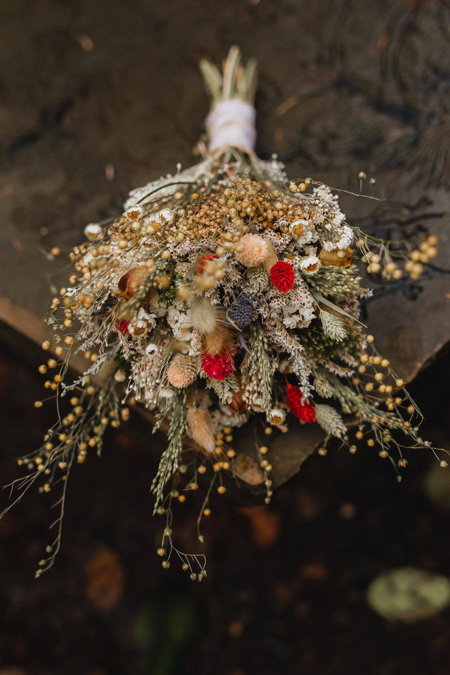 cream, green, and red wedding bouquet with wildflowers and wheatgrasses