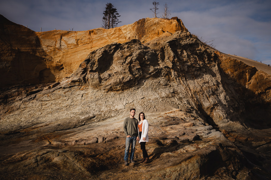 Couple standing in sunlight at Oregon Coast