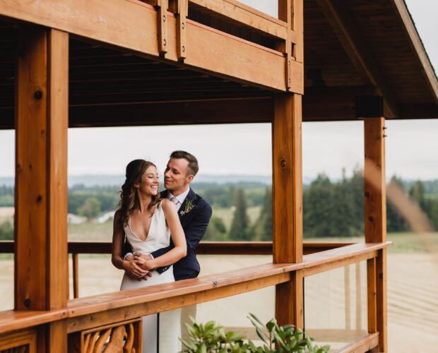 Bride and groom are embracing at Scholls Valley Lodge in wine country.